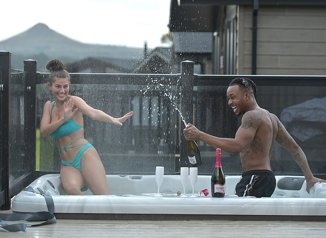 Ahh! Rebecca backed away as her beau lunged towards her with the bottle of bubbles