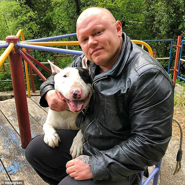 Anna Turaeva, 42, pictured with her dog, has spoken of her horror after she was stopped from boarding a plane until she could prove that she was a woman to security officials