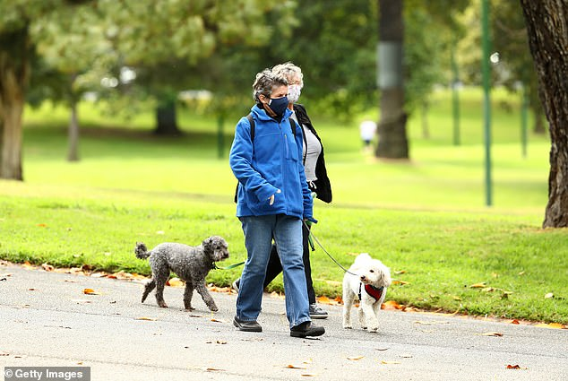 Residents are seen walking through Fitzroy Gardens on September 30 in Melbourne