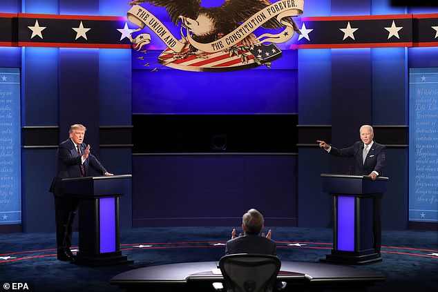 Trump (L) and Democratic presidential candidate Joe Biden (R) spar while moderator Chris Wallace (C) attempts to gain control during the first 2020 presidential election debate at Samson Pavilion in Cleveland, Ohio