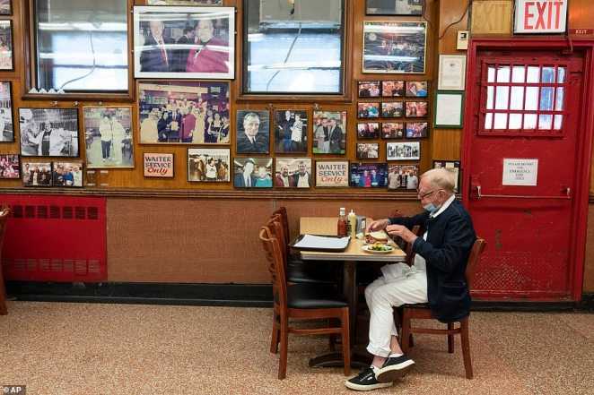 A man enjoys one of Katz's famous cold meat sandwiches on Wednesday at lunchtime