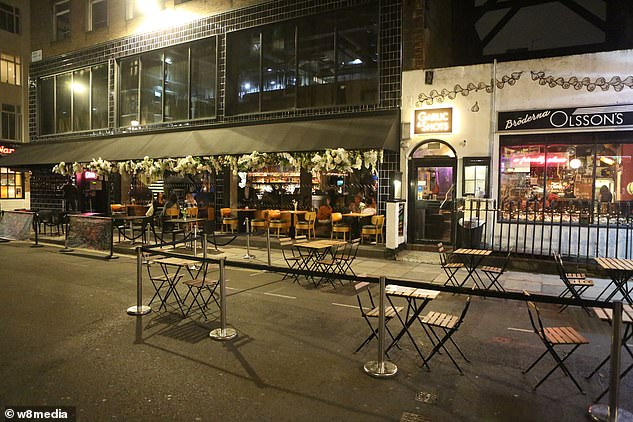 Tables in Soho, west London, were empty as restaurants and bars closed at 10 p.m.