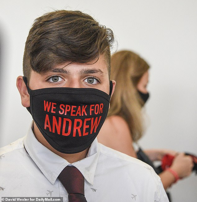 A friend of Andrew McMorris wears a mask in his honor at the sentencing