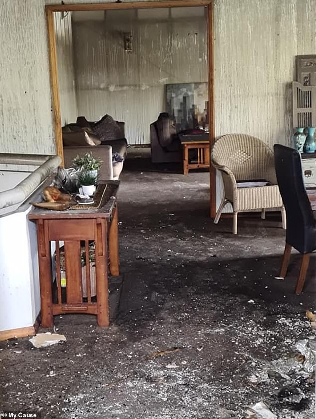 The schoolgirl woke up her mother,Linda Barrett, but after a fire blanket failed to prevent the spread of the blaze Mrs Barrett, her three daughters and their two dogs fled the home (pictured)