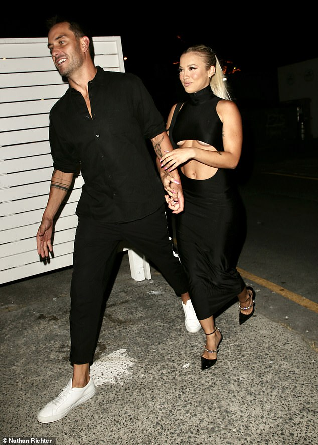Racy: Tammy Hembrow, 26, (R) set pulses racing as she flaunted plenty of underboob in a black dress alongside boyfriend Matt Poole at the opening of his Gold Coast restaurant