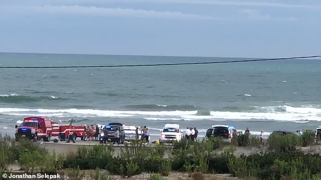 Authorities said a mother-of-five drowned on Tuesday while trying to save three of her children from rip currents at a North Wildwood, New Jersey, beach (pictured)