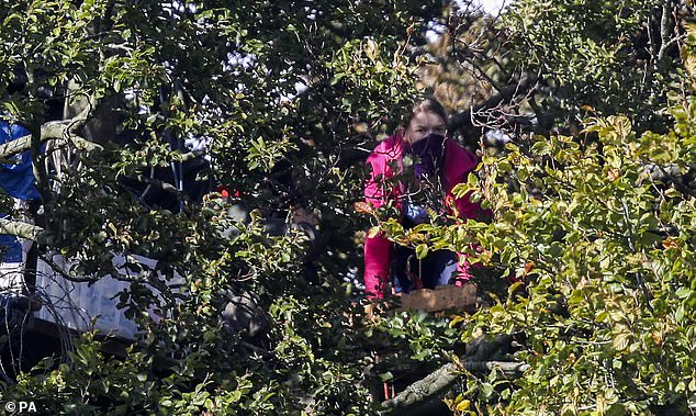 Protestors camped in trees that they are trying to stop being felled at Jones' Hill Wood, near Aylesbury Vale in Buckinghamshire, one of the woodlands which is due to be affected by the building of HS2