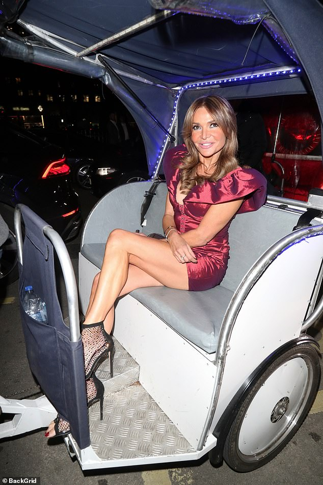 Grand arrival:Never one to shy away from making an entrance, Lizzie Cundy was at it again on Thursday as she arrived for a night out at Annabel's in London