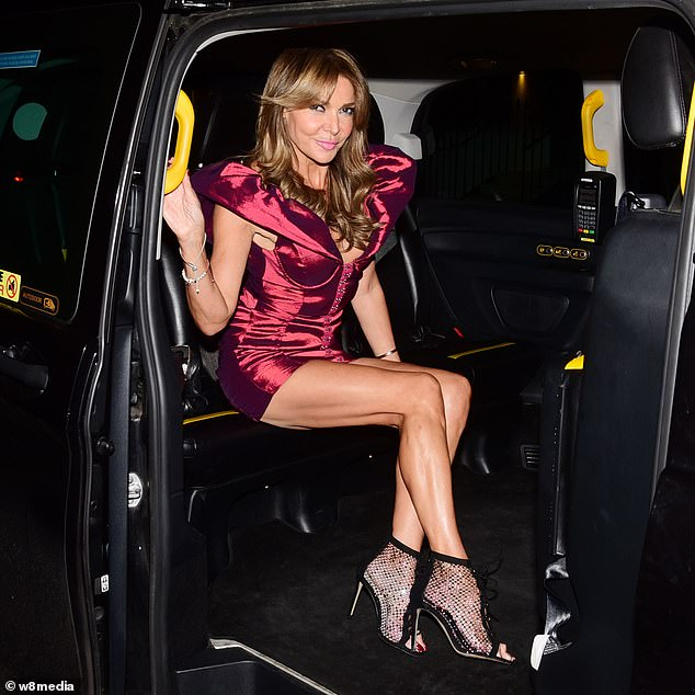 Night on the tiles: Lizzie's perilously high hem showed off her bronzed leggy pins