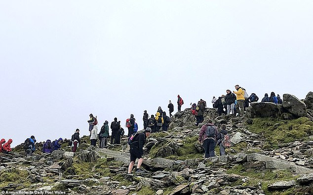 Crowds of walkers seen gathering near the top of the mountain this weekend. Llanberis mountain rescue team, Britain's busiest, carried out seven rescues on Sunday