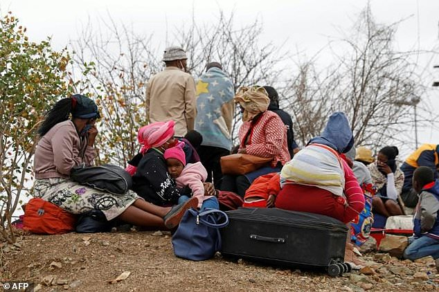 Zimbabweans await their fate after being caught trying to cross into South Africa to buy groceries