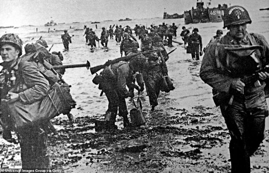 American soldiers go ashore during the Normandy landing operations on D-Day, Tuesday June 6, 1944 during World War II