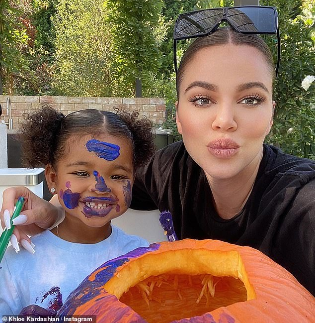 Khloe Kardashian has a 'family pumpkin carving day' with ...