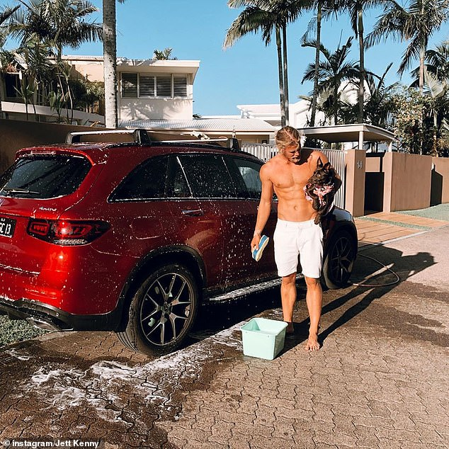 Sunny Sunday: In October, Jett shared a picture to Instagram of himself posing shirtless while washing the vehicle with his dog.