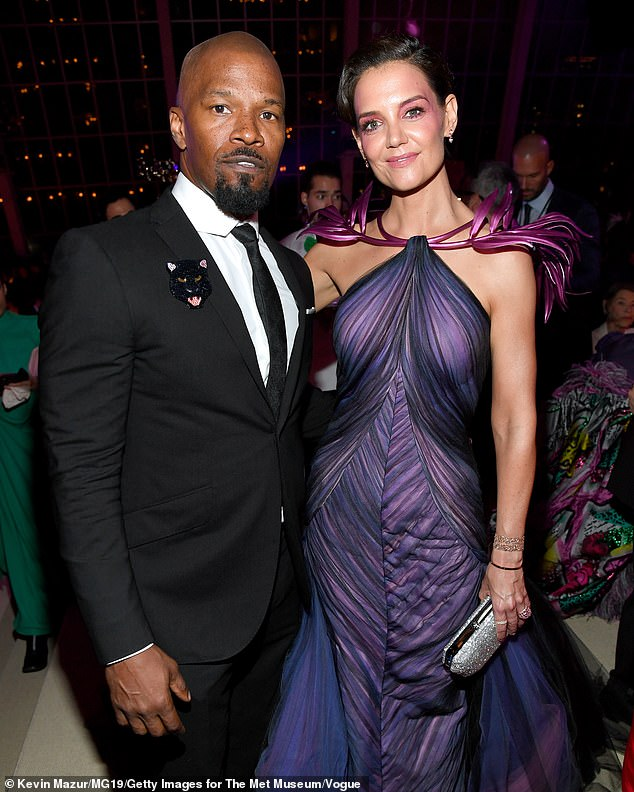 Exes: Emilio is Katie's first real relationship since ending her on/off six-year romance in May 2019 with Oscar winner Jamie Foxx (L), who co-starred with her ex-husband Tom Cruise in Michael Mann's 2004 movie Collateral (pictured in 2019)