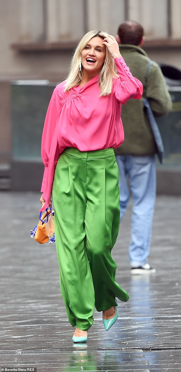 Clashing: The Pussycat Doll donned a pair of bright emerald trousers that clashed with her pink silk top