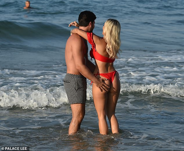 Cheeky!Dan, 30, clearly couldn't get enough of his girlfriend, as at one stage he rested his hand on her peachy posterior while paddling in the sea together