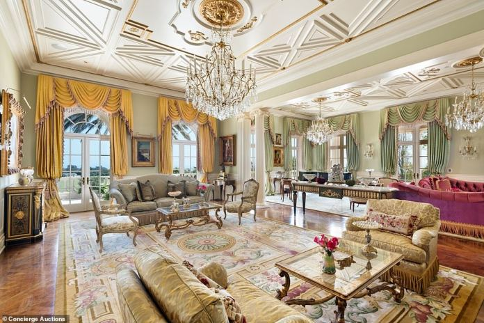 The Mediterranean main house is decorated with luxurious chandeliers, intricate ceilings and oversize drapes