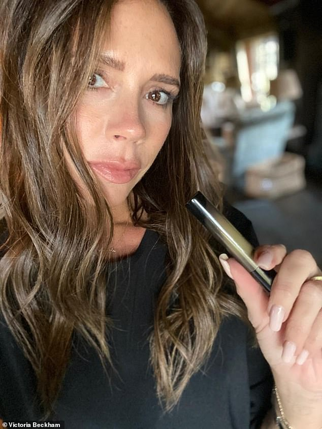 Posh Spice RETURNS as Victoria Beckham proves the perfect model for new lipstick in sultry selfie