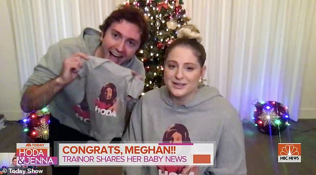 """With a onesie: The blonde beauty made the announcement on the Today show alongside her boyfriend.  """"We're so excited we couldn't sleep,"""" she said after Daryl blurted out, """"We're pregnant!"""