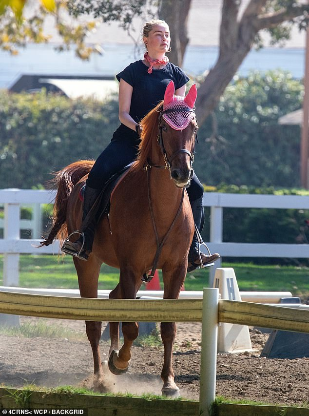 Pretty in Pink: Later, while enjoying her riding session, Amber matched her accessories to those worn by her horse