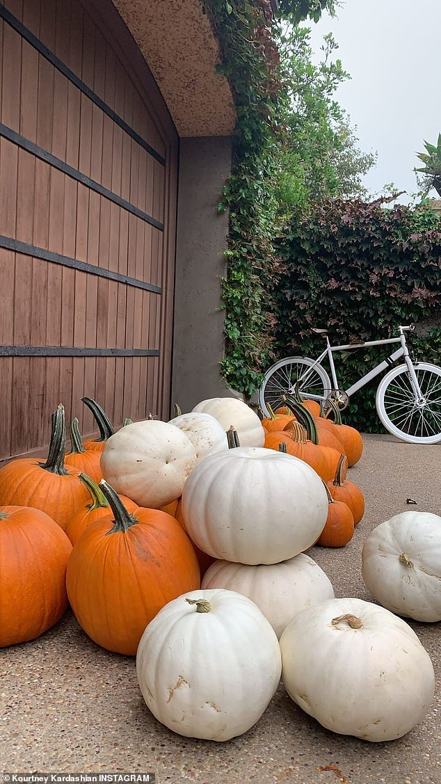 Plentiful for the Poosh founder: Outside her home were over a dozen orange and white pumpkins proving she loves abundance