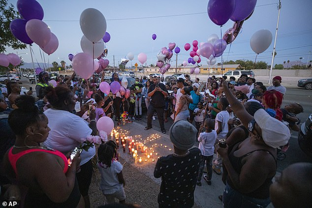 Family and friends mourn the death of Sayah at a vigil Tuesday in Las Vegas