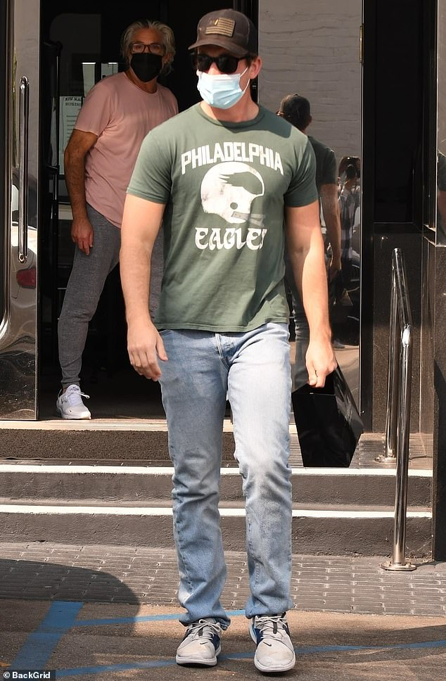 Girl's best friend: Miles Teller showed some Philadelphia Eagles love Friday in a green t-shirt and faded jeans, as he went jewelry shopping at XIV Karats in Beverly Hills, ahead of wife Keleigh Sperry's 28th birthday