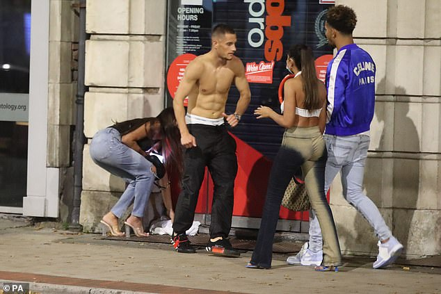 Vast swathes of the north are set to be placed in Tier Three lockdown, with pubs, gyms and casinos among the businesses told to close for half a year - with monthly assessments. Pictured: Revellers in Manchester tonight