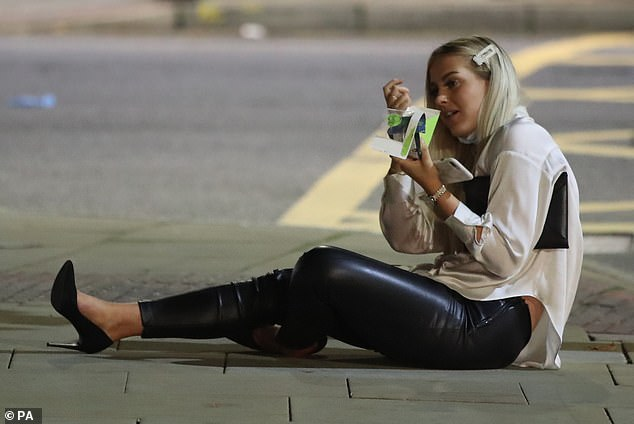 One woman ate a sandwich on the pavement while on a night out in Manchester on Sunday