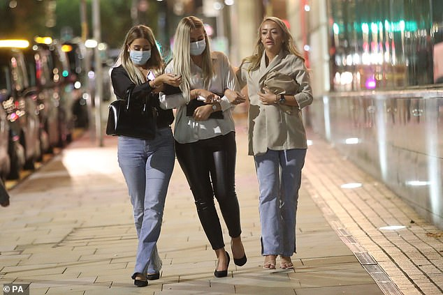 Drunk partygoers were seen pounding the pavements outside some of Manchester's nightlife spots before kick-out time at 10pm