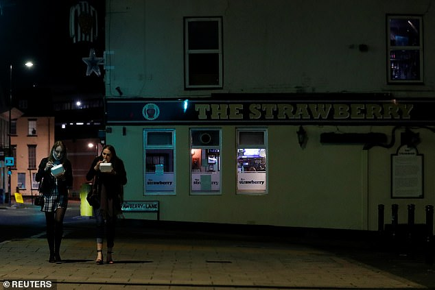 Revellers leave The Strawberry Pub as the spread of coronavirus continues, in Newcastle Upon Tyne