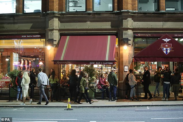 People outside the Revolucion de Cuba bar in Manchester on Sunday. Many locals rushed to enjoy what may be their last bar trip in six months