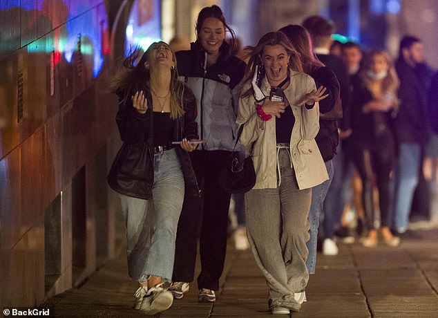 In Newcastle Upon Tyne, three revellers were seen laughing as they made their way along the pavement