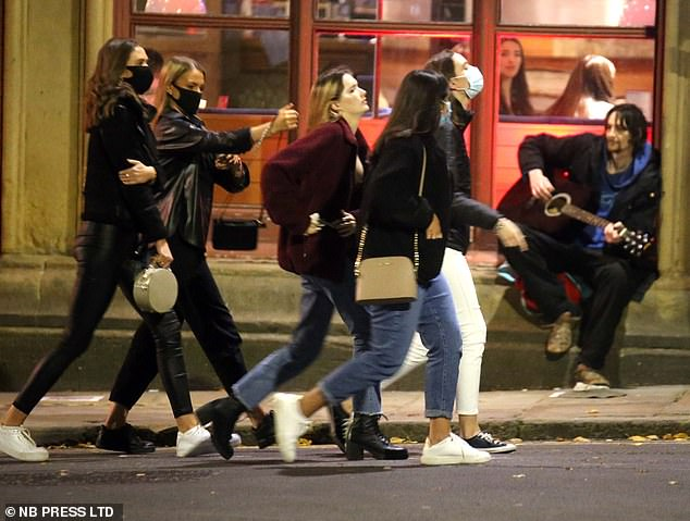 Mask-clad partygoers were seen enjoying a night out in Leeds. It comes ahead of a potential government announcement tomorrow