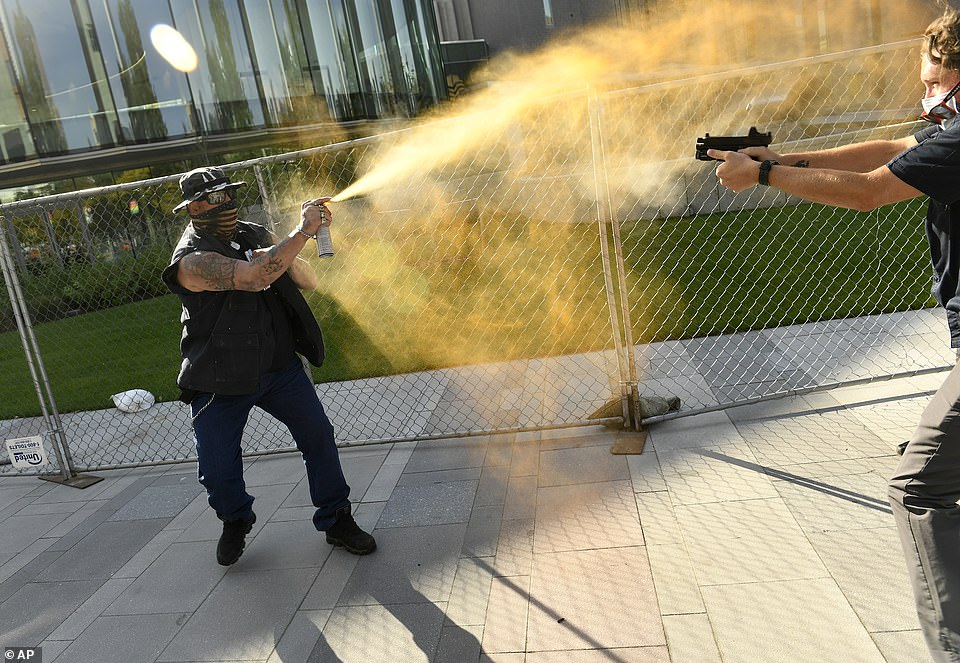 A second image showed Keltner deploying mace at Dolloff, who had pulled a handgun out of his waistband. Dolloff was contracted by local TV station News9 through Pinkerton, a private detective and security agency