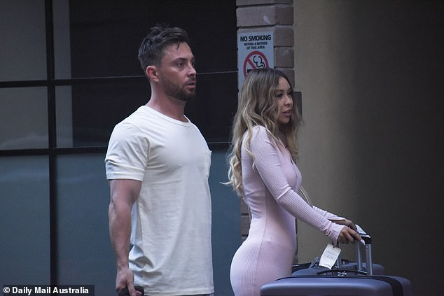 And action! Jason was spotted filming scenes with his as-yet-unidentified bride (right) outside an apartment complex in Sydney's business district on Thursday, October 1st