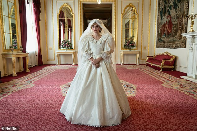 The Crown star Emma Corrin has revealed it took costume designers five fittings to recreate Princess Diana's bridal look for her upcoming role, despite the hit Netflix series not showing the wedding. She is pictured in costume