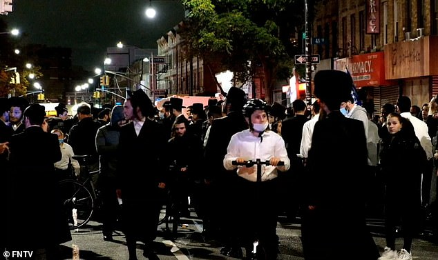 A crowd of Orthodox Jewish protesters gathered to express anger at the restrictions