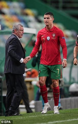 Ronaldo shook hands with coach Fernando Santos after exiting Spain game