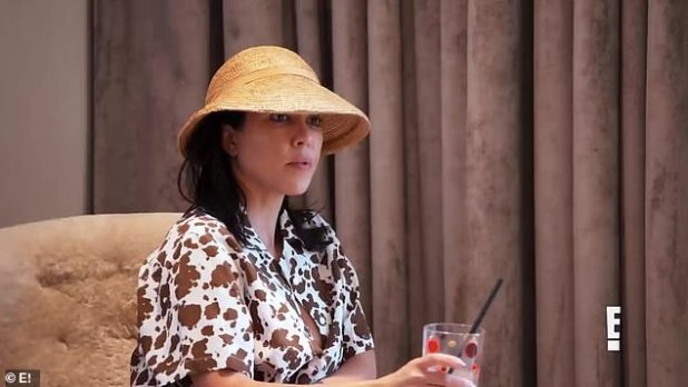 No Insight: Courtney is seen listening as she wears a straw hat and a cow print shirt with her hair as a drink