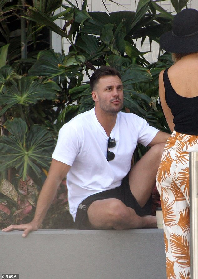 Break time! The Amazing Race Australia host Beau Ryan (pictured) chatted away to a production assistant as he enjoyed a break from filming in Queensland last week