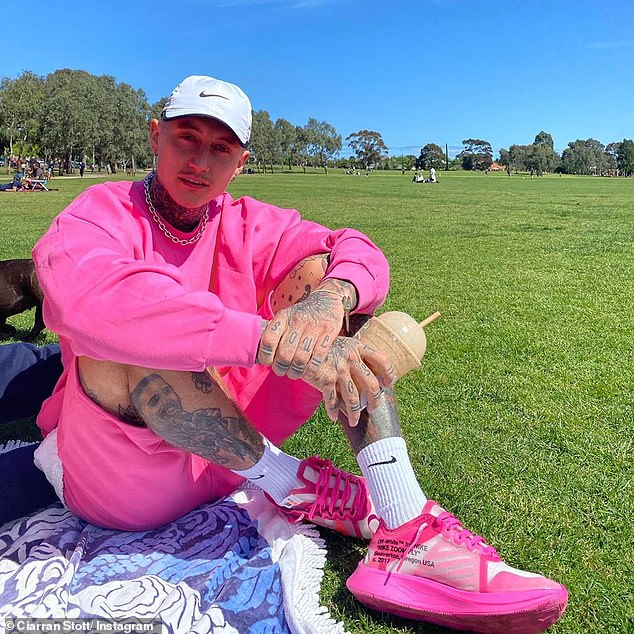 Pink perfection: On Wednesday, Ciarran Stott (pictured) turned heads as he posed in a fluro pink ensemble