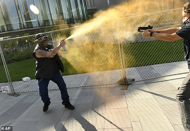 Keltner is seen deploying mace at Dolloff, who pulled a handgun out of his waistband. Former district attorney Stanley Garrettsaid one of the biggest questions facing prosecutors, police and eventually the courts is: 'If someone is threatening to use mace, and then does use mace, to what extent is the other person entitled to respond with deadly force?'