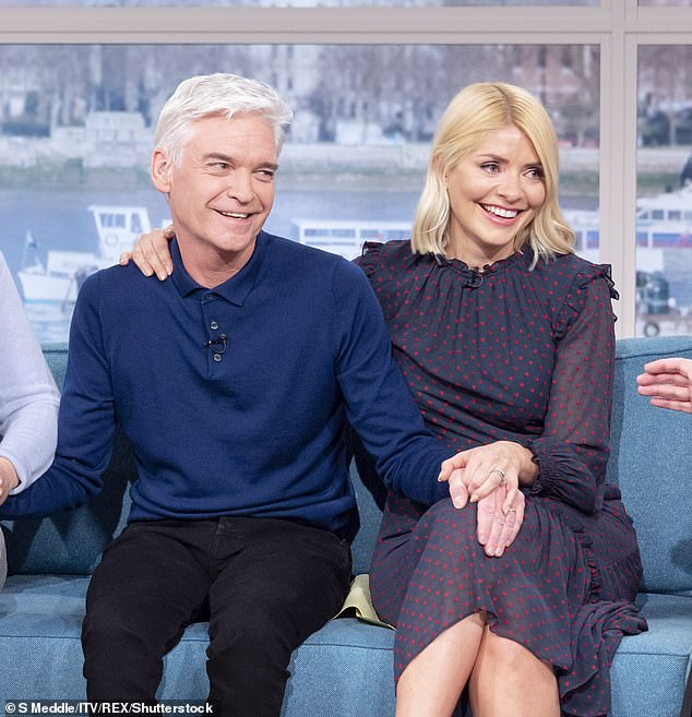 'We couldn't have been closer':Phil addressed false reports about a feud between himself and his longtime co-host Holly, 38, as he credited himself 'lucky' for receiving her support
