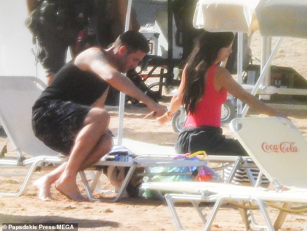 Off they go: The duo made their way to their next location after spending time on the beach furniture