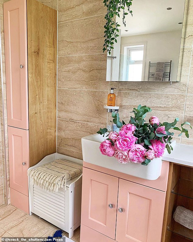 The spacious family bathroom features a double sink, pictured, separate shower and bath