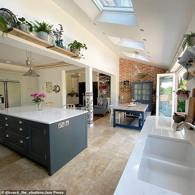 Jen and Miles Rothbury, both 36, bought the four-bedroom house in Bramhall, Cheshire, for £580,000 despite the need for extensive work because it allowed them to live in an upmarket neighbourhood close to good schools for sons Leo, seven, and Magnus, five. Pictured, the stunning open plan kitchen-living-dining room following the £140,000 renovation