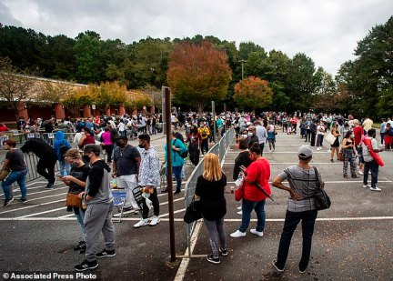 MARIETTA, GEORGIA: Hundreds line up for early voting at a polling center in Marietta. Black people are going to the polls by the thousands and waiting in lines for hours to vote early in Georgia
