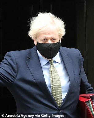Prime Minister Boris Johnson leaves 10 Downing Street in Westminster yesterday for Prime Minister's Questions